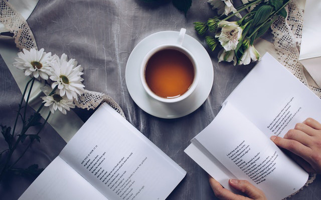 book and coffee on desk