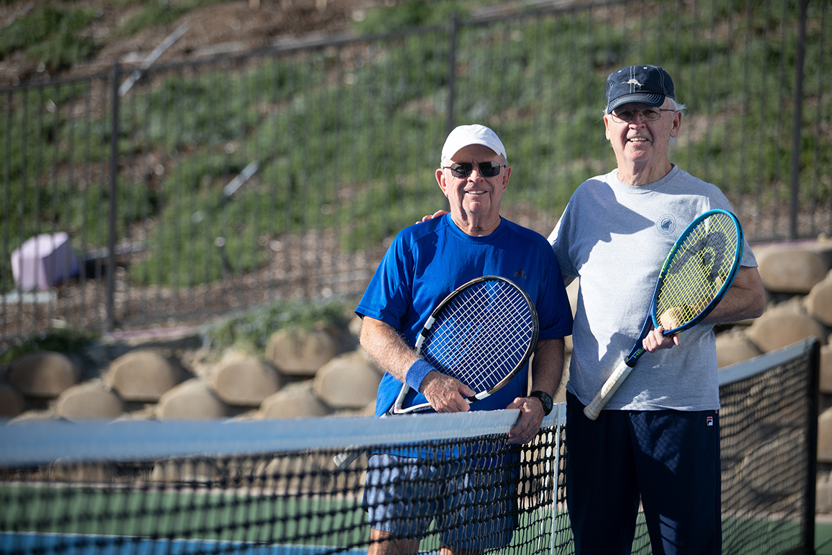 Two friends playing tennis