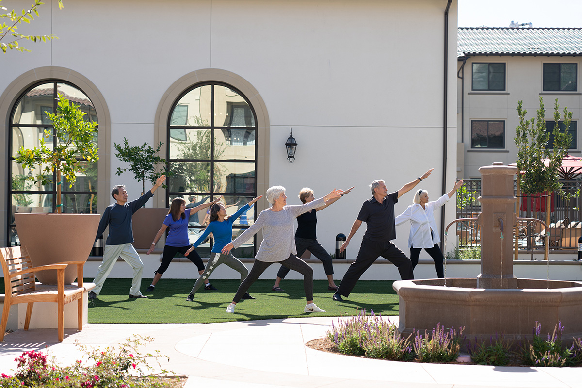residents stretching and doing yoga together