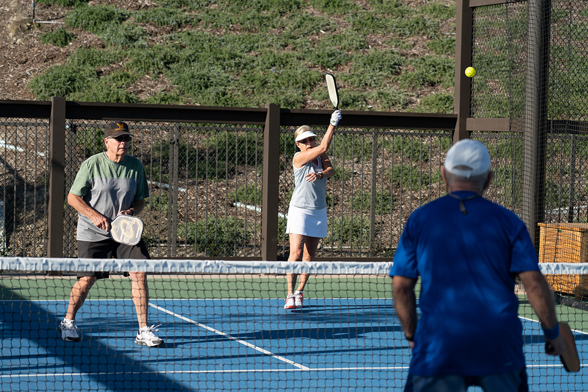 residents playing tennis together