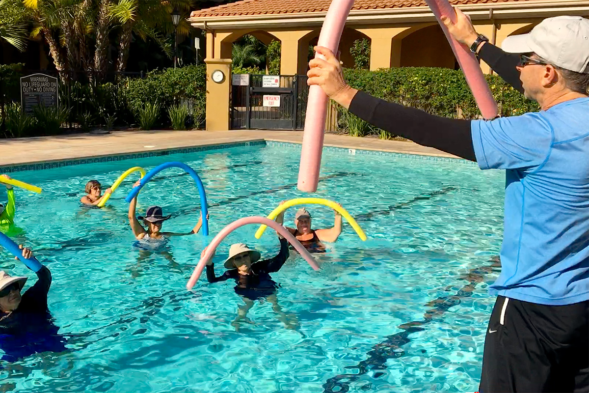 Residents swimming in the pool together doing arobics