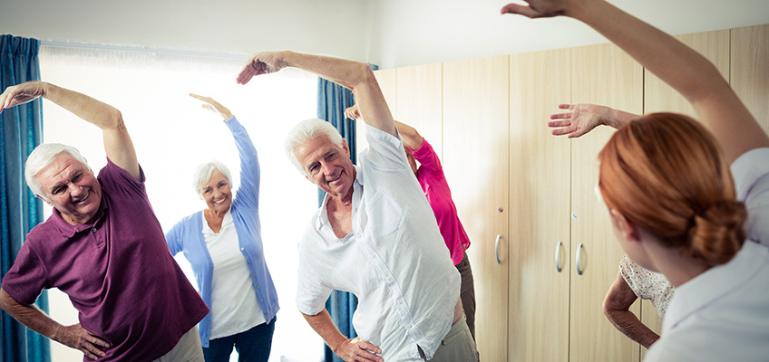 Seniors Stretching in exercise class
