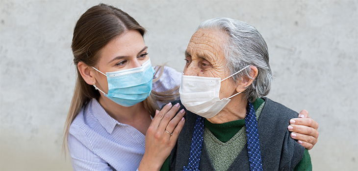 Two Loved Ones Visiting With Masks On