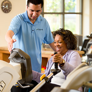 man helping with physical therapy