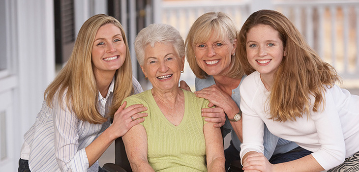 four generations of women smiling