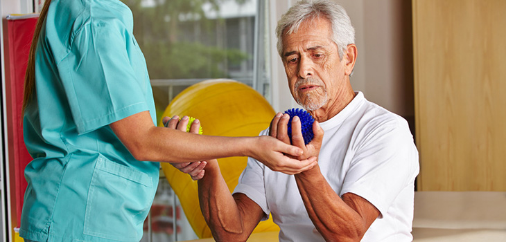 Nurse helping resident with some physical therapy