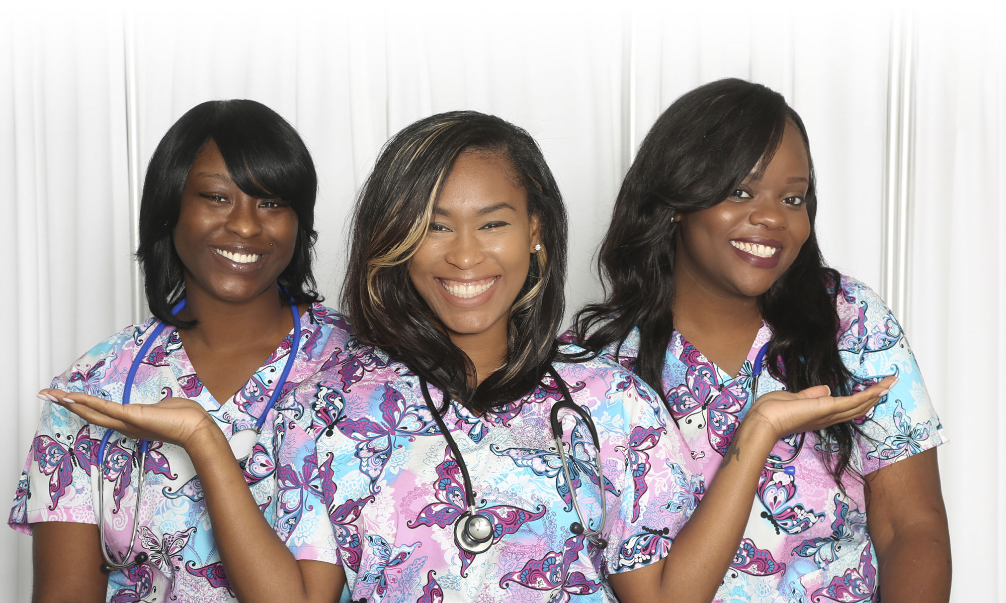 3 nurses smiling together at the facility