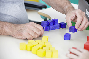 Resident stacking blocks as physical therapy