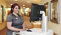 Canyon vista Certified Nursing Assistant working at computer