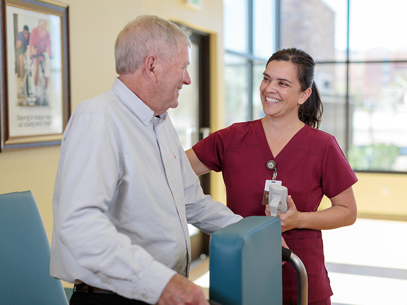 Certified Nursing Assistant smiling with resident