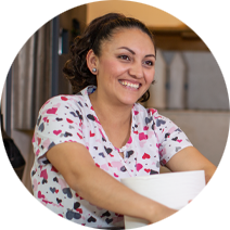 housekeeper smiling and holding roll of paper towels