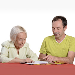 Speech therapist working with a female resident