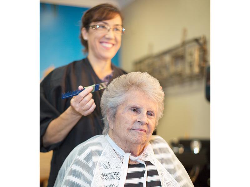Resident receiving a haircut