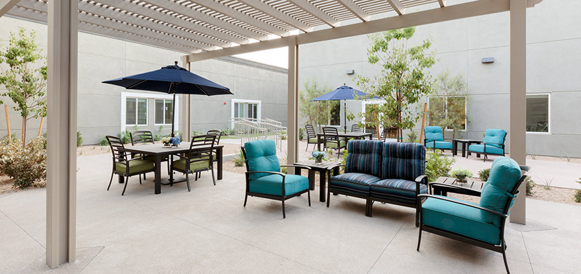 Outside seating area with shaded and un-shaded seating.