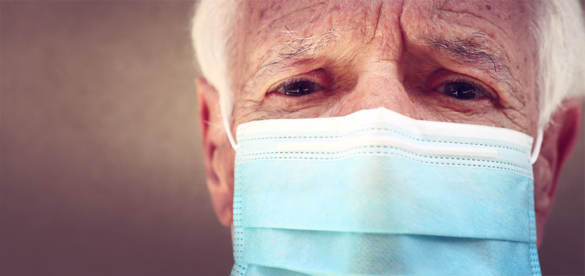 elderly man with a medical face mask
