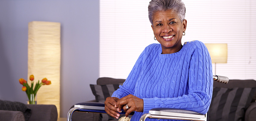patient in a wheelchair smiling