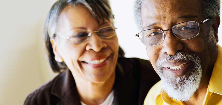 man and woman smiling and laughing together