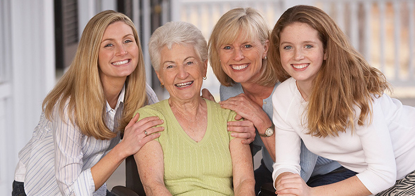 4 generations of women gathered around each other smiling