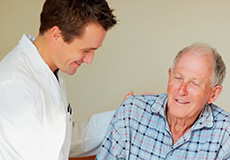 doctor talking to a patient on a bed