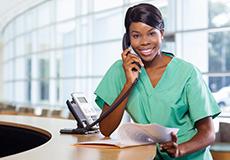 nurse answering the reception phone