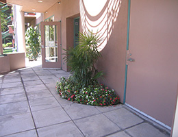 Anaheim Memorial covered entrance with flower bed