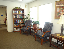 Bexton sitting area with bookcase and 2 chairs