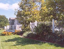 Cardosa Village gate and grass area surrounding the community