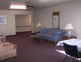 Casa De Pinos waiting area with couches, chairs, and tables