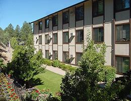 Casa De Pinos lawn and exterior of building