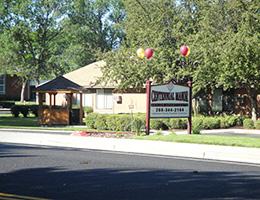 Centennial Manor wooden sign with balloons