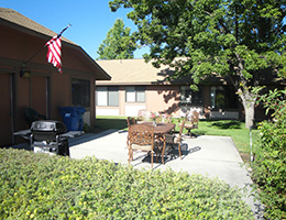 Centennial Manor sitting area, BBQ, and US flag