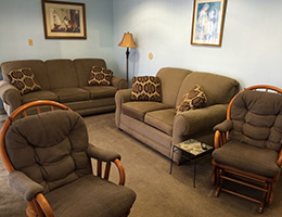 matching couches and chairs in a living area