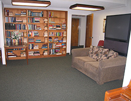 The Concord reading room with large TV and bookcases