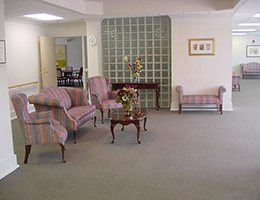 Creekbend Gardens sitting area with upholstered chairs, couches, bench and table