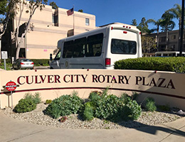 Culver City Rotary Plaza sign and transportation bus