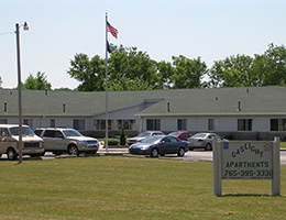 front of the facility with signage and an american flag on a pole