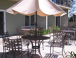 Harbor exterior tables, chairs and umbrella