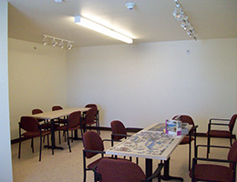 Game room with long tables and chairs