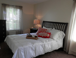 Kings Grant resident bedroom with a breakfast tray