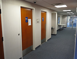 a hallway with bathroom doors