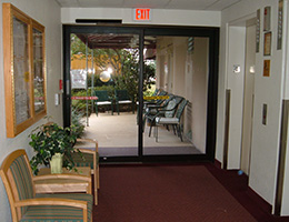hallway leading into the facility with an automatic glass door
