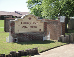 Lindsay Place Apartments brick sign