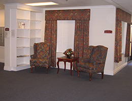 Lowell Place sitting area with upholstered chairs and matching curtains