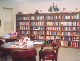 a small library area with lots of books on the shelves