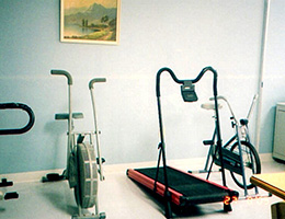 cardio exercise equipment with a picture on the wall