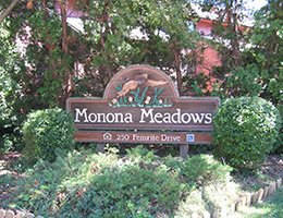Manona Meadows sign surrounded by greenery