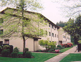 Marymount Manor exterior with walking paths and lawn