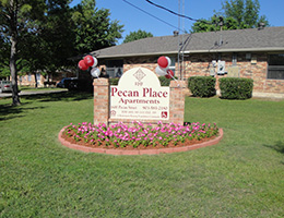 Pecan Place sign with balloons