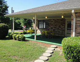Pecan Place front entryway with stepping stones