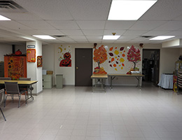 indoor area with orange wall murals